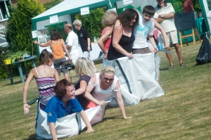 Sack race competitors fall over!