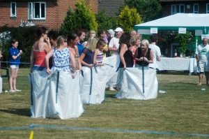 Sack race competitors line up